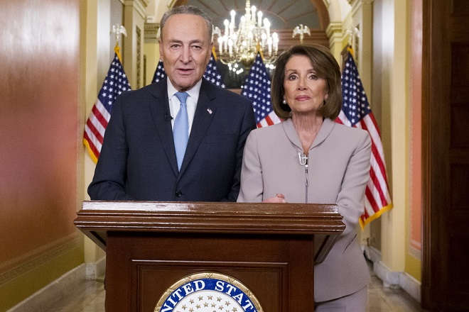 epa07270386 US Speaker of the House Nancy Pelosi (R) and Senate Minority Leader Democrat Chuck Schumer (L) pose for pictures after delivering a live address to the nation on Capitol Hill in Washington, DC, USA, 08 January 2019. House Speaker Pelosi and Senate Minority Leader Schumer delivered their address in response to US President Donald J. Trump's live address to the nation on border security and the ongoing partial shutdown of the federal government. A partial shutdown of the US federal government continues since Congress and Trump failed to strike a deal before a 22 December 2018 funding deadline due to differences regarding border security.  EPA/MICHAEL REYNOLDS