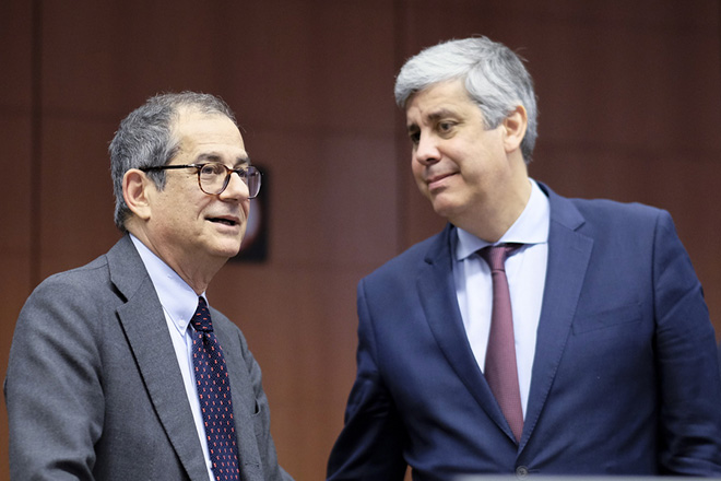epa07306576 Italian Minister of Economy and Finance Giovanni Tria and Eurogroup President Portuguese Finance Minister Mario Centeno (R) talk during Eurogroup Finance Ministers' meeting in Brussels, Belgium, 21 January 2019.  EPA/OLIVIER HOSLET