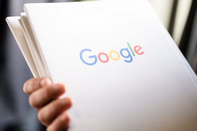 epa07308769 A Google employee holds press information files prior to a press conference on the new Google office in Berlin, Germany, 22 January 2019. On 22 January 2019 Google sets up a new office in the center of Berlin.  EPA/CLEMENS BILAN