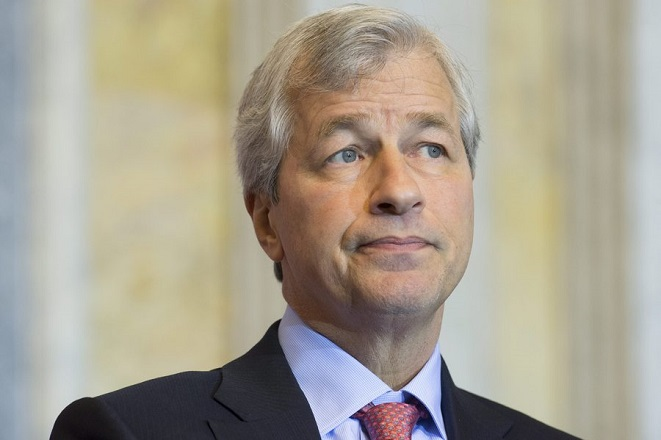 epa05050930 CEO of JP Morgan Chase Jamie Dimon participates in a panel discussion entitled 'Financial Inclusion to Advance Global Growth and Equality', during the Financial Inclusion Forum hosted by the US Department of the Treasury and the US Agency for International Development (USAID) at the Treasury Department in Washington, DC, USA, 01 December 2015. The forum brought together leaders from the US and foreign governments, financial institutions and other corporations, and nonprofits; to discuss ways to increase access to safe and affordable financial services.  EPA/MICHAEL REYNOLDS  EPA/MICHAEL REYNOLDS