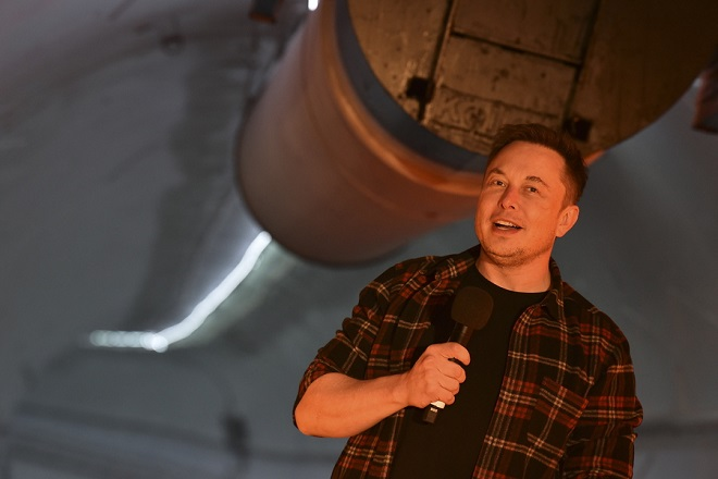 epa07239486 Elon Musk, co-founder and chief executive officer of Tesla Inc., speaks during an unveiling event for the Boring Company Hawthorne tunnel in Hawthorne, California, USA, 18 December 2018. The Boring Company officially opened the Hawthorne tunnel, a preview of Elon Musk's larger vision to ease Los Angeles traffic.  EPA/ROBYN BECK / POOL