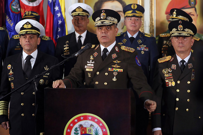 epa07315819 Venezuela's Defense Minister Vladimir Padrino Lopez (C) speaks at a press meeting in Caracas, Venezuela, 24 January 2019. Defense Minister Vladimir Padrino said that the 'soldiers of the Fatherland' would not accept a president imposed 'under the shadow of dark interests.' Other officers are not identified.  EPA/MIGUEL GUTIERREZ