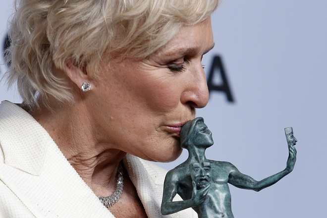 epaselect epa07326836 Glenn Close poses with the SAG Award for Outstanding performance by a Female Actor in a Leading Role in 'The Wife' during the 25th annual Screen Actors Guild Awards ceremony at the Shrine Auditorium in Los Angeles, California, USA, 27 January 2019.  EPA/NINA PROMMER