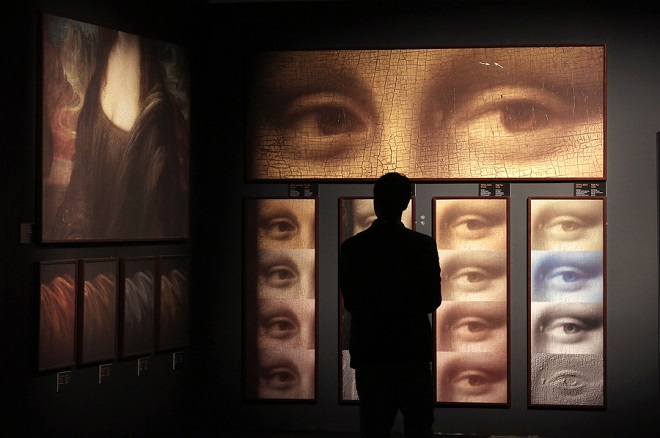 epa07204262 A man looks at part of the exhibition 'Leonardo Da Vinci - 500 Years of Genius' in Athens, Greece, 02 December 2018. Combining three exhibitions on Leonardo da Vinci into one, the exhibition uses digital technology to create a rich audiovisual experience, transport visitors through space and time to explore the life of a polymath and inventor that laid the foundations for some of the most important inventions in human history. A special audiovisual experience set up with the assistance of the Leonardo da Vinci Museum in Rome, the Lumiere Technology Institute in Paris and specialists from Italy and France will pay a tribute to Leonardo da Vinci 500 years after his death, demonstrating the full range of his achievements.  EPA/SIMELA PANTZARTZI