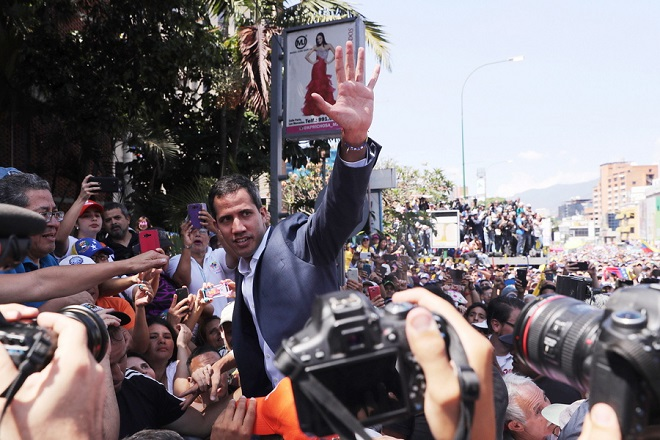 epa07339192 President of the Venezuelan National Assembly Juan Guaido (C) arrives to deliver a speech during a march against Nicolas Maduro's Government, in Caracas, Venezuela, 02 February 2019. Maduro and his opponent National Assembly leader Juan Guaido have called on their supporters to take to the streets as international pressure increased on Maduro to resign. Guiado had declared himself interim president of Venezuela on 23 January and promised to guide the country toward new election as he consider last May's election not valid.  EPA/Miguel Gutierrez