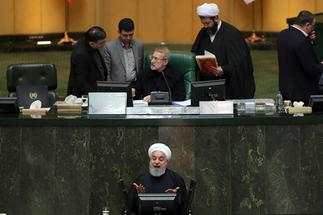 epa07342038 Iranian President Hassan Rouhani (below, C) speaks to parliament to defend his nomination for the new Health and Medical Education minister Saeed Namaki, during a parliament session in Tehran, Iran, 04 February 2019. Media reported that Iranian parliament approved Namaki as the health and medical education minister.  EPA/ABEDIN TAHERKENAREH