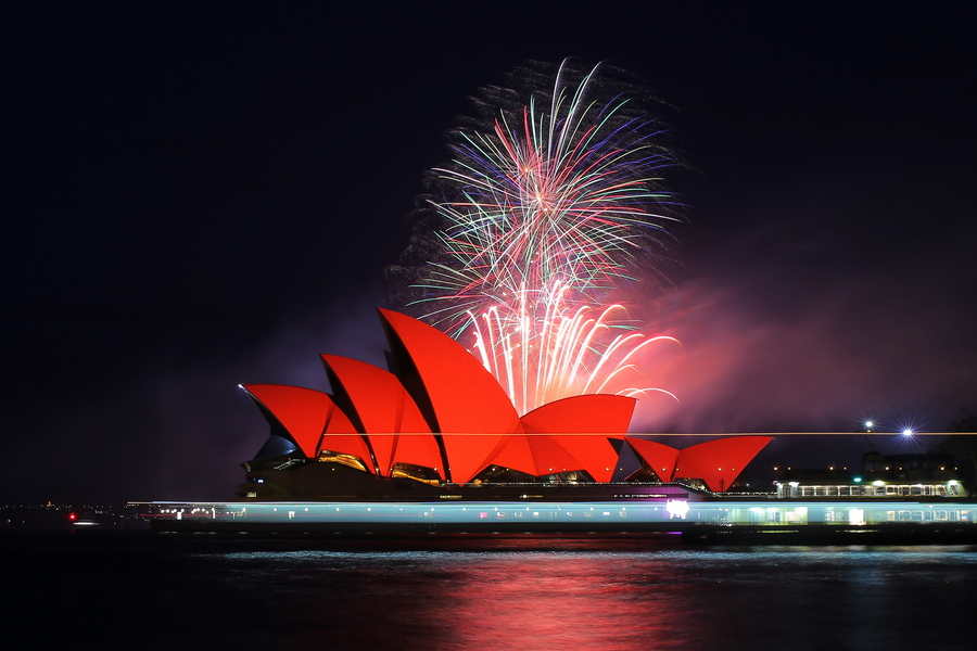 epa07342308 Fireworks explode behind the Sydney Opera House as it glows red as part of celebrations for Chinese Lunar New Year of the pig, in Sydney, Australia, 04 February 2019. Sydney's official Chinese New Year festival is the largest Lunar New Year celebration outside of Asia.  EPA/Steven Saphore AUSTRALIA AND NEW ZEALAND OUT
