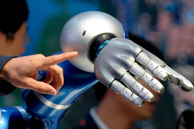 epa03192109 An artificial robot hand is prepared for display at the China stand at the 'Hannover Messe' on the fair ground in Hanover, Germany, 22 April 2012. The 'Hannover Messe' international industrial fair in Hanover is officially opened later on 22 April with a ceremony that will be attended by German Chancellor Angela Merkel and Chinese Prime Minister Wen Jiabao. China is this year's partner country of the fair which gathers around 5,000 companies from 69 countries to take part in the largest industrial exhibition from 23 to 27 April 2012.  EPA/PETER STEFFEN
