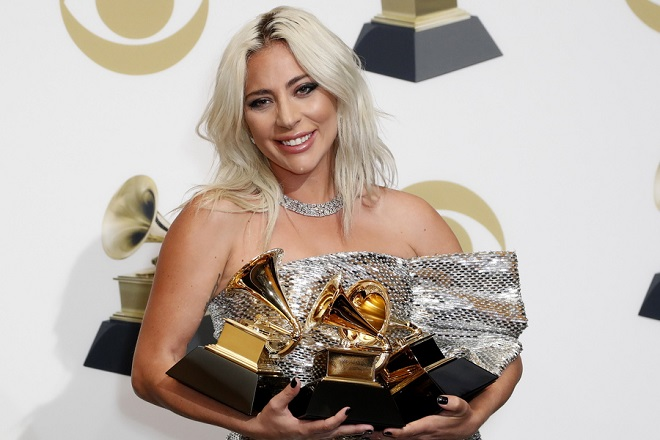 epa07361380 US singer-songwriter Lady Gaga poses in the press room with the Grammy for: Best Song Written For Visual Media, Best Pop/Duo Group Performance, and Best Pop Solo Performance during the 61st annual Grammy Awards ceremony at the Staples Center in Los Angeles, California, USA, 10 February 2019.  EPA/JOHN G MABANGLO
