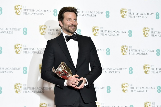 epa07360232 US actor Bradley Cooper with the award for original music of 'A Star is Born' in the press room during the 72nd annual British Academy Film Awards at the Royal Albert Hall in London, Britain, 10 February 2019. The ceremony is hosted by the British Academy of Film and Television Arts (BAFTA).  EPA/NIK HALLEN