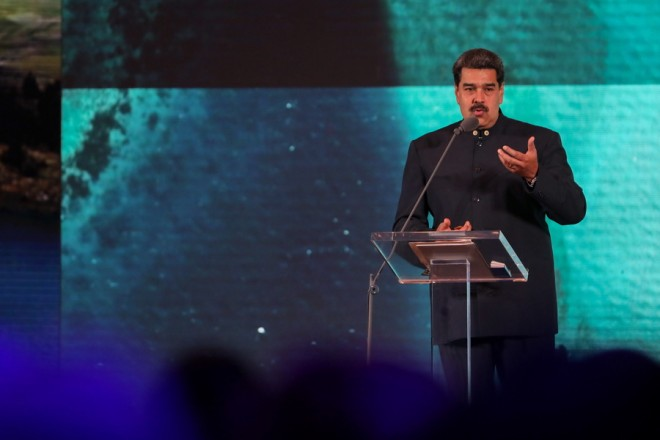 epa07363250 Venezuelan President Nicolas Maduro speaks during the launch of the country brand strategy 'Venezuela open to the future' to promote tourism, at the Alba Hotel, in Caracas, Venezuela, 11 February 2019.  EPA/Cristian Hernández