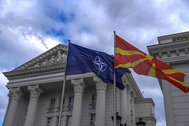 epa07364091 The NATO flag flutters alongside the Macedonian flag in front of the government building in Skopje, The Former Yugoslav Republic of Macedonia (FYROM), 12 February 2019. The former Yugoslav Republic of Macedonia's government is due to change the name of the country after the ratification of the 'Protocol of the North Atlantic Treaty for the Accession of North Macedonia' whereby Greece will approve the accession of its northern neighbor to NATO under its new name, as provided by the Prespes Agreement signed by Athens and Skopje.  EPA/GEORGI LICOVSKI