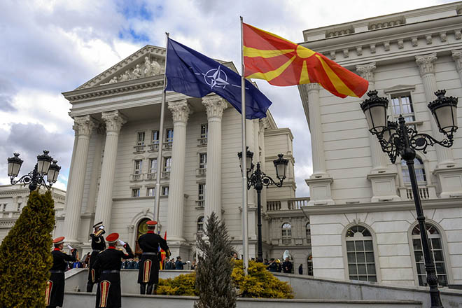epa07364096 Members of a honor guard hoist the NATO flag alongside the Macedonian flag in front of the government building in Skopje, The Former Yugoslav Republic of Macedonia (FYROM), 12 February 2019. The former Yugoslav Republic of Macedonia's government is due to change the name of the country after the ratification of the 'Protocol of the North Atlantic Treaty for the Accession of North Macedonia' whereby Greece will approve the accession of its northern neighbor to NATO under its new name, as provided by the Prespes Agreement signed by Athens and Skopje.  EPA/GEORGI LICOVSKI