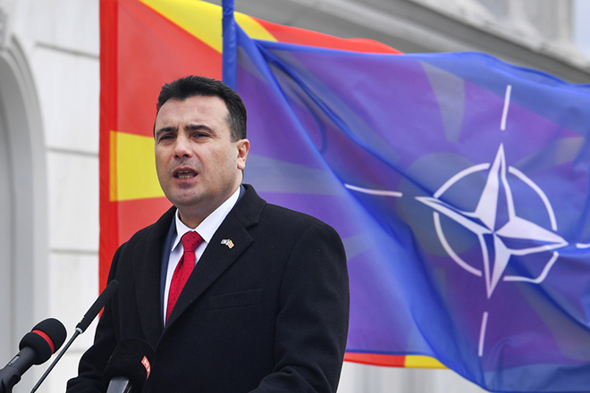 epa07364106 FYR of Macedonian Prime Minister Zoran Zaev addresses the nation during the ceremony of raising the NATO flag alongside the Macedonian flag in front of the government building in Skopje, The Former Yugoslav Republic of Macedonia (FYROM), 12 February 2019. The former Yugoslav Republic of Macedonia's government is due to change the name of the country after the ratification of the 'Protocol of the North Atlantic Treaty for the Accession of North Macedonia' whereby Greece will approve the accession of its northern neighbor to NATO under its new name, as provided by the Prespes Agreement signed by Athens and Skopje.  EPA/GEORGI LICOVSKI