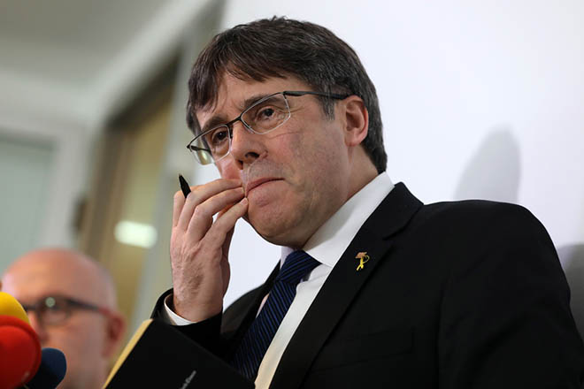 epa07364149 Former Catalan regional President Carles Puigdemont speaks during a press conference at the Catalonian office in Berlin, Germany, 12 February 2019. The trial against the Catalan politicians involved in the illegal pro-independence referendum kicks off in the Spanish capital with nine of the 12 pro-independence leaders accused of rebellion and embezzlement for their role in the Catalan illegal independence referendum back in 2017, while the other three accused face disobedience charges.  EPA/FELIPE TRUEBA