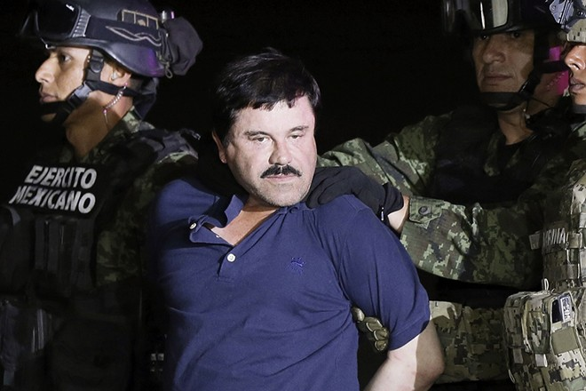 epa07365162 (FILE) - Mexican drug lord Joaquin 'El Chapo' Guzman escorted by authorities after his detention, in Mexico City, Mexico,  08 May 2016.  Media reports that Joaquin 'El Chapo' Guzman has been found guilty on all 10 counts at his drug trafficking trial at a federal court in New York, New Yory USA on 12 Februray 2019.  EPA/JOSE MENDEZ *** Local Caption *** 53259187