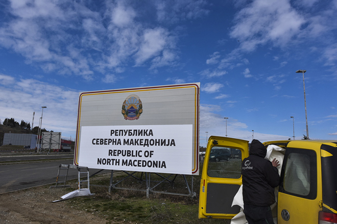 epa07366852 Workers leaves after they fix the sign Republic of North Macedonia at the border crossing Bogorodica between North Macedonia and Greece on 13 February 2019. FYR of Macedonia Government is due change the name of country after ratification of the Protocol of the North Atlantic Treaty for the Accession of Republic of North Macedonia whereby Greece will approve the accession of its northern neighbor to NATO under its new name, as provided by the Prespes Agreement signed by Athens and Skopje.  EPA/GEORGI LICOVSKI