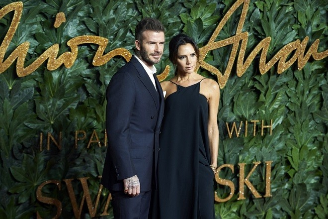 epa07222529 Former English international footballer David Beckham (L) and his wife fashion designer Victoria Beckham arrive for The Fashion Awards in London, Britain, 10 December 2018. The Fashion Awards is showcasing both British and international individuals and businesses who have made the most outstanding contributions to the fashion industry.  EPA/Niklas Halle'n