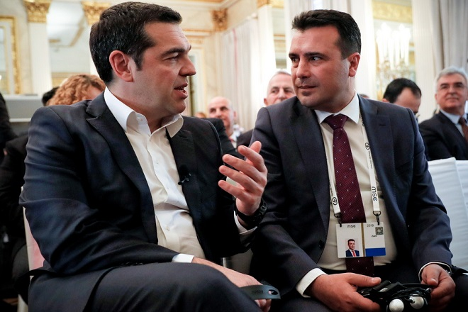 epa07374650 Greek Prime Minister Alexis Tsipras (L) and North Macedonian Prime Minister Zoran Zaev (R) attend a discussion session during the 55th Munich Security Conference (MSC) in Munich, Germany, 16 February 2019. From 15 to 17 February, politicians, various experts and guests from all over the world will discuss global security issues in their annual meeting.  EPA/RONALD WITTEK