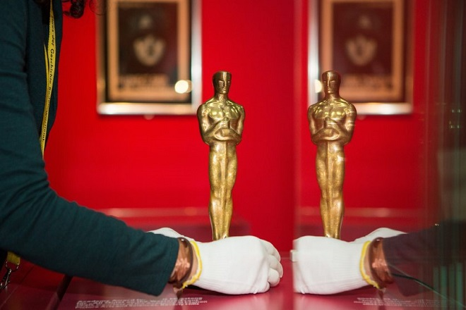 epa05653910 A woman positions an Oscar statue for the first extensive exhibition about the German-born US Hollywood film producer Carl Laemmle (1867-1939) at the House of History in Stuttgart, Germany, 30 November 2016. The show entitled 'Carl Laemmle presents… A Swabian Jew invents Hollywood' that explores the life and work of Laemmle, a founder of Universal Studios, opens to the public on 09 December.  EPA/SILAS STEIN