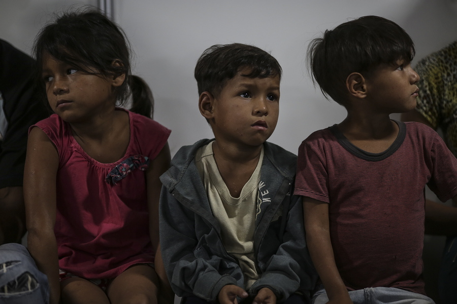 epa06848741 Venezuelan children wait with their parents to obtain authorization to enter Brazil, at the headquarters of the Brazilian customs office, in the Federal Police of Pacaraima, Brazil, on 27 June 2018 (issued 28 June 2018). The Brazilian government will build a new shelter to welcome the hundreds of Venezuelans who have fled the economic, social and political crisis of their country and who currently live crowded in the streets of Pacaraima, a small town on the border with Venezuela. The reception center will have capacity for 700 people and will receive the most vulnerable immigrants who are detained in Pacaraima because they lack the necessary documentation to enter Brazil or do not have money to continue on their way.  EPA/Antonio Lacerda