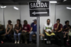 epa06848743 Hundreds of Venezuelan immigrants wait to obtain authorization to enter Brazil, at the headquarters of the Brazilian customs office, in the Federal Police of Pacaraima, Brazil, on 27 June 2018 (issued 28 June 2018). The Brazilian government will build a new shelter to welcome the hundreds of Venezuelans who have fled the economic, social and political crisis of their country and who currently live crowded in the streets of Pacaraima, a small town on the border with Venezuela. The reception center will have capacity for 700 people and will receive the most vulnerable immigrants who are detained in Pacaraima because they lack the necessary documentation to enter Brazil or do not have money to continue on their way.  EPA/Antonio Lacerda