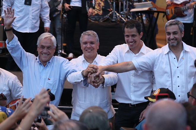 epa07389297 (L-R) Chilean President Sebastian Pinera, Colombian President Ivan Duque, President of the Venezuelan National Assembly Juan Guaido, who claimed the interim presidency of Venezuela past January, and Paraguayan President Mario Abdo Benitez attend the Venezuela Aid Live concert in Cucuta, Colombia, 22 February 2019.  EPA/MAURICIO DUENAS CASTANEDA