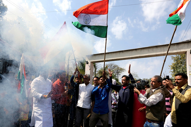 epa07398050 Bhartiya Janta Party (BJP) workers hold an Indian national flag as they react on the street after hearing news that the Indian Air Force carried out strikes with 12 Mirage 2000 fighter jets across the Line of Control (LoC) near Pakistan, in Bhopal, India, 26 February 2019. According to media reports on 26 February 2019, the Indian Air Force carried out air strikes with 12 Mirage jets, which dropped 1,000 kilogram bombs on an alleged terrorist camp across the Line of Control (LoC) near Pakistan. The air strikes occurred two weeks after a suicide bomber from the Pakistan-based Jaish-e-Mohammed group detonated a car bomb next to a security convoy traveling in Pulwama, killing over 40 Central Reserve Police Force (CRPF) soldiers.  EPA/SANJEEV GUPTA