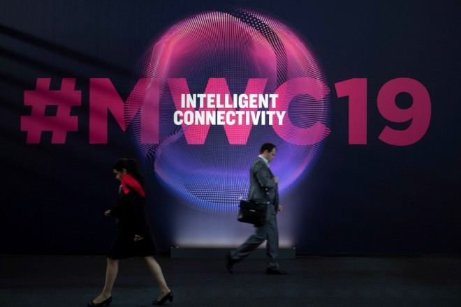 epa07400777 Several people attend the third day of Mobile World Congress (MWC) in Barcelona, northeastern Spain, 27 February 2019. The MWC, running until 28 February, brings the lastest mobile innovations and leading-edge technology from more than 2,400 companies.  EPA/Enric Fontcuberta