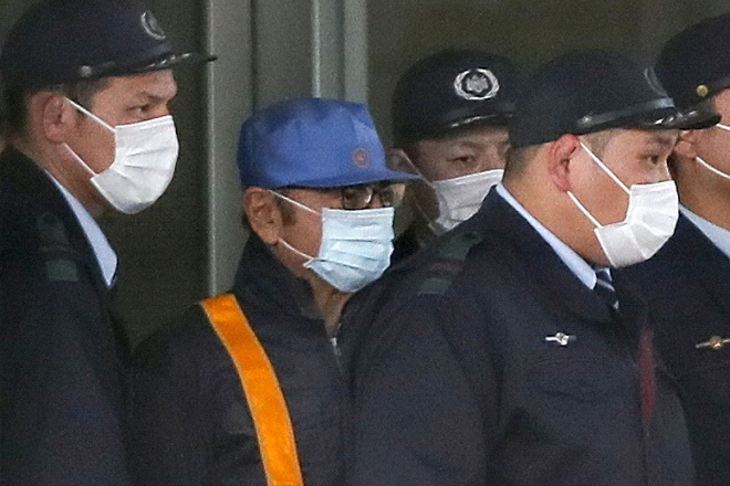 epa07416502 A group of Tokyo Detention Center guards walk with a man purportedly identified as former Nissan Motor CEO Carlos Ghosn (2-L) as they leave the detention center in Tokyo, Japan, 06 March 2019. The former Nissan and Renault chairman was accused by Japanese authorities of under-reporting his income by tens of millions of dollars and aggravated breach of trust. It is expected Ghosn will be released after Tokyo District Court granted him bail on 05 March.  EPA/KIMIMASA MAYAMA