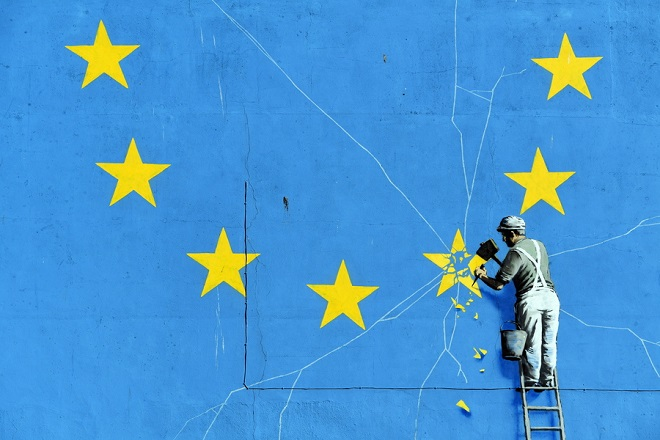 epa07418901 (01/66) A close-up view of a Brexit inspired mural by anonymous British street artist Banksy depicting the European flag in Dover, Britain, 15 February 2019. The graffiti that appeared on a building near Dover's ferry terminal shows a worker removing one of the 12 stars from the EU flag. The Port of Dover, handling up to 10.000 trucks a day, estimated that no-deal Brexit can lead to almost 30 kilometers (17 miles) long lines to the customs. Britain is scheduled to leave the European Union on 29 March 2019, two years after Prime Minister Theresa May invoked Article 50, the mechanism to notify the EU of her country's intention to abandon the member's club after the tightly-contested 2016 referendum. The results of that referendum exposed a divided nation. Leave won, claiming 52 percent of the overall vote. Voters in England and Wales came out in favor of leave, while Scotland and Northern Ireland plumped for remain. It was still unclear on what terms the UK would leave the EU, with lawmakers having rejected Prime Minister Theresa May's initial deal hammered out with the EU, the fruit of years of negotiations. There was also talk of extending the March 29 deadline, which would delay Brexit, as well as the floating of a second referendum, with the opposition Labour Party of Jeremy Corbyn appearing to now throw its weight behind that. Citizens and industries across the UK, including the banking, tourism and farming sectors, and many of whom rely on exporting products or bringing in goods from Europe, will have to adapt in a post-Brexit Britain, whether there is a deal with the EU or not.  EPA/NEIL HALL  ATTENTION: For the full PHOTO ESSAY text please see Advisory Notice epa07418899 , epa07418900