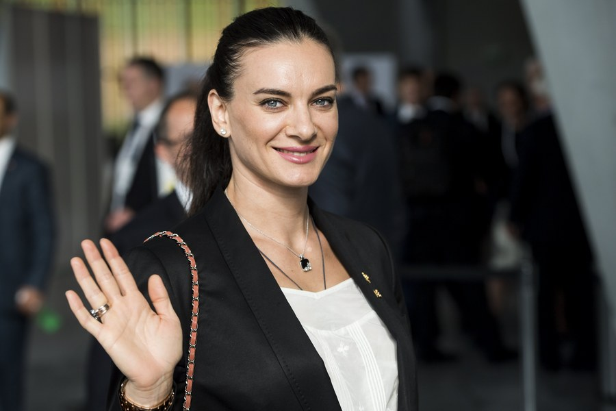epa06080474 Former Russian pole vaulter, Yelena Isinbayeva, arrives during the presentation of the Los Angeles 2024 Candidate City Briefing for members of the International Olympic Committee (IOC) vat the SwissTech Convention Centre, in Lausanne, Switzerland, 11 July 2017.  EPA/JEAN-CHRISTOPHE BOTT