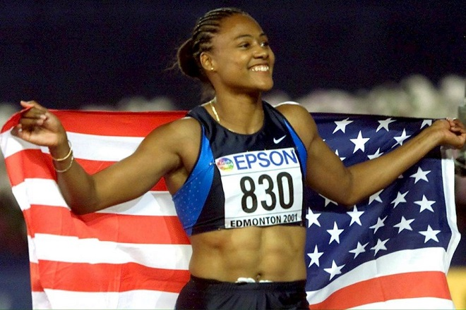 epa01219265 (FILE) A file photo of US Marion Jones celebrating after winning the women's 200m at the 8th World Athletics Championships in Edmonton, 10 August 2001. Disgraced Olympian Marion Jones was sentenced to six months in prison 11 January 2008 after admitting she lied about using steroids and taking part in a check-fraud scheme 2007.  EPA/ANJA NIEDRINGHAUS