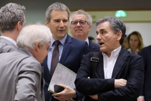 epa07429044 Greek Finance Minister Euclid Tsakalotos (R) and Austrian Finance Minister Hartwig Loeger (3-L) stand together with participants prior to the Eurogroup Finance Ministers' meeting in Brussels, Belgium, 11 March 2019. According to the agenda of the European Commission the Eurogroup will be informed on the main findings of the 2nd enhanced surveillance mission to Greece and will discuss the housing markets in the eurozone. Others are not identified.  EPA/OLIVIER HOSLET