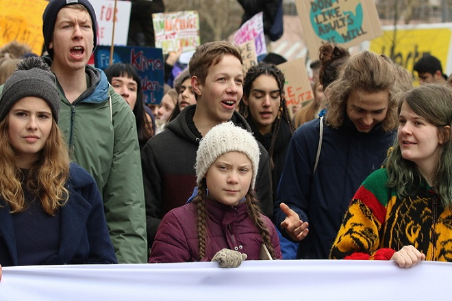 epa07436827 (FILE) - Swedish climate activist Greta Thunberg (C) and German activist Luisa Neubauer (L) march with protesters during a 'Fridays for Future' demonstration against climate change in Hamburg, northern Germany, 01 March 2019 (reissued 14 March 2019). According to media reports 14 March 2019, 16-year-old Greta Thunberg, founder of the 'Youth Strike for Climate' movement, has been nominated for the Nobel Peace Prize by three Norwegian lawmakers.  EPA/FOCKE STRANGMANN