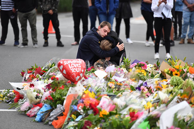 epa07441392 Members of the public mourn at a flower memorial near the Al Noor Masjid on Deans Rd in Christchurch, New Zealand, 16 March 2019. A gunman killed 49 worshippers at the Al Noor Masjid and Linwood Masjid on 15 March. The 28-year-old Australian suspect, Brenton Tarrant, appeared in court on 16 March and was charged with murder.  EPA/MICK TSIKAS  AUSTRALIA AND NEW ZEALAND OUT
