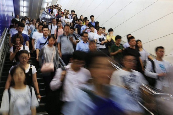 epa05420047 A picture made available on 11 July 2016 shows commuters traveling in a subway station in Beijing, China, 30 June 2016. China has a current population of 1.38 billion as of 06 July 2016 according to the latest United Nations estimates. This is equivalent to 18.72 percent of the total world population, making it the most populous country in the world. The most populous country of the world has a peculiar demographic situation as a result of more than three decades of the 'one child policy'. With 40 million more of men than women (and around 18 million more of boys under 15 than girls of the same age, according to official data), it is forecasted that by 2020 there will be at least 30 million of young men unable to find a spouse in the country. World Population Day falls on 11 July.  EPA/HOW HWEE YOUNG